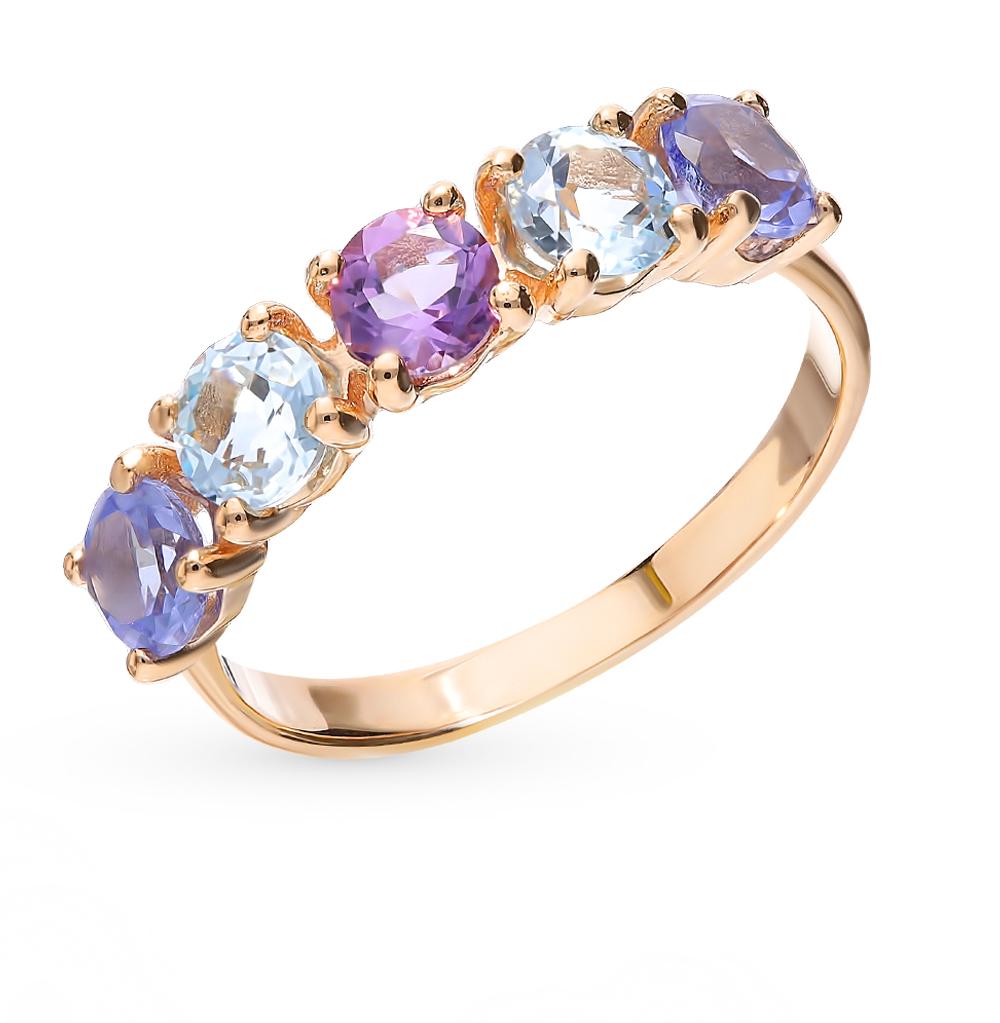золотое кольцо с танзанитом и топазами