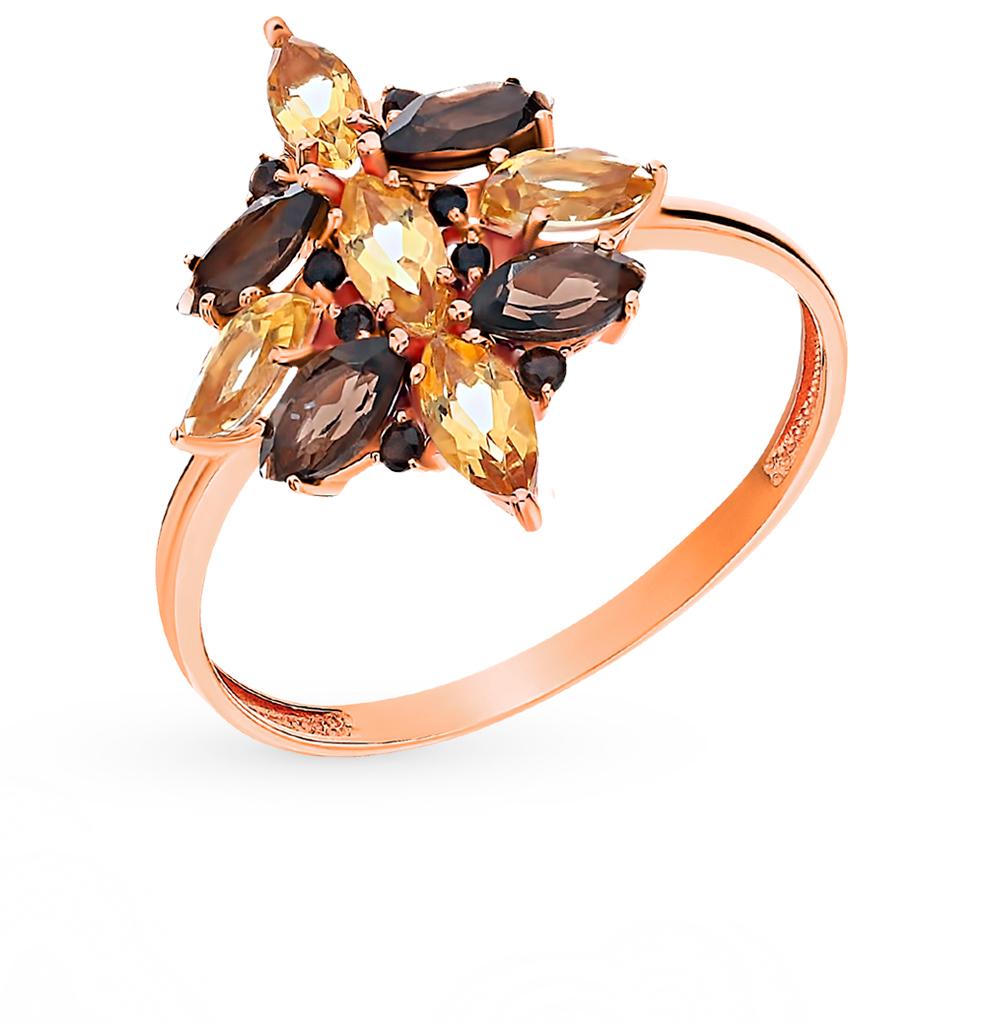 золотое кольцо с раухтопазами и цитринами