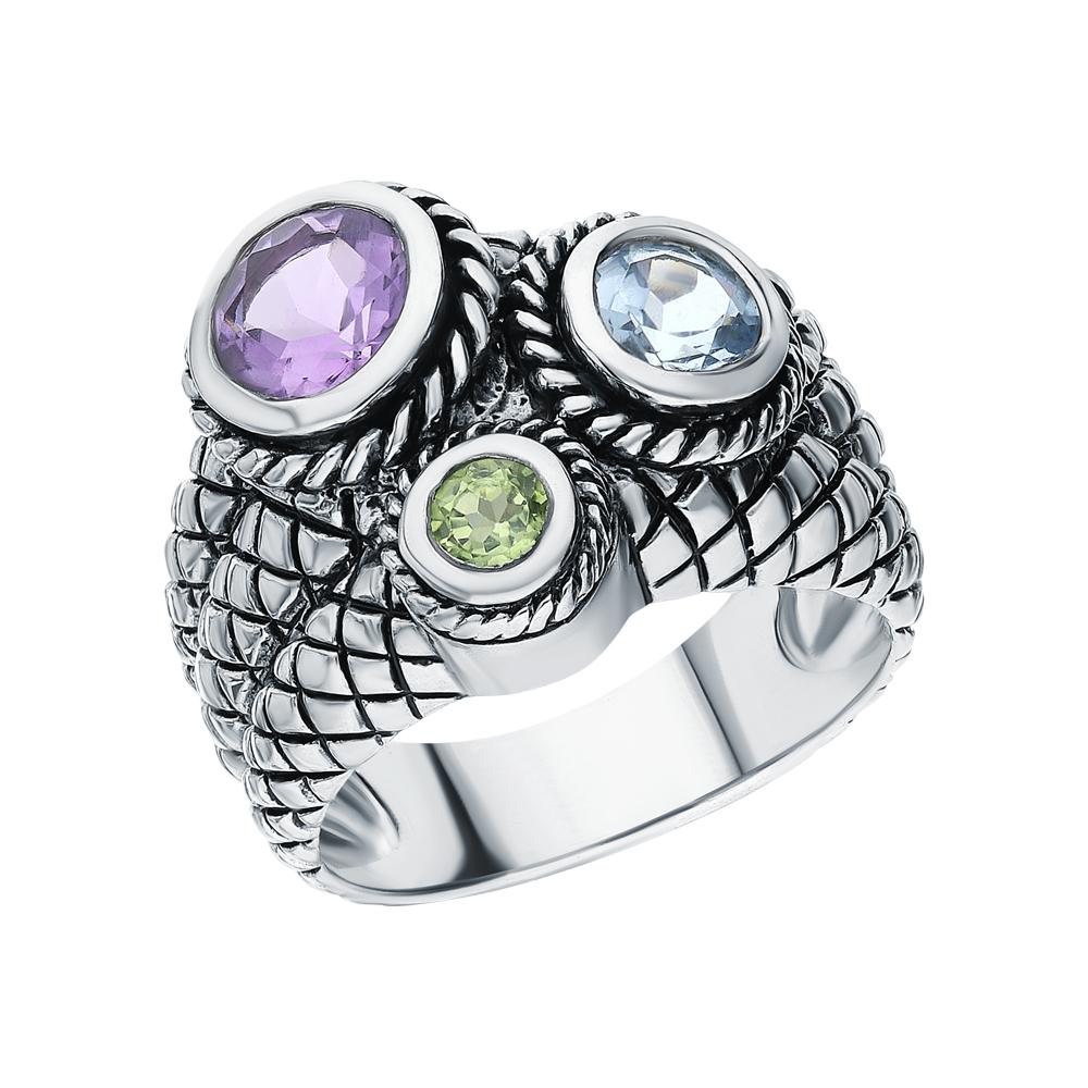 Фото «Серебряное кольцо с хризолитом, аметистом и топазами»