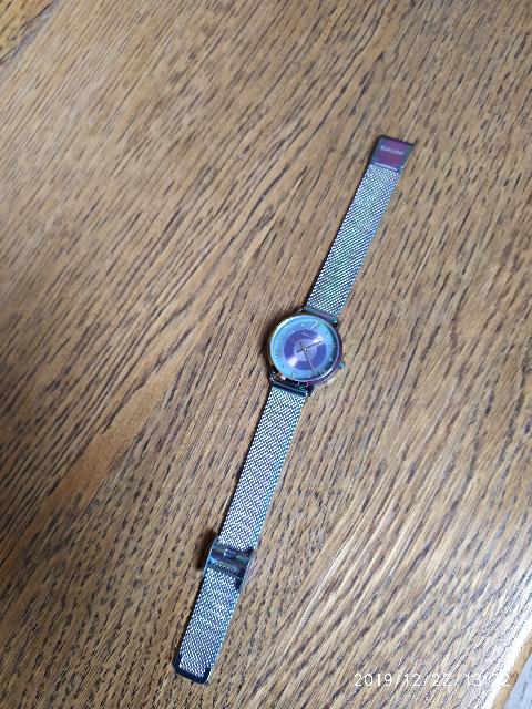 Женские часы на миланского браслете