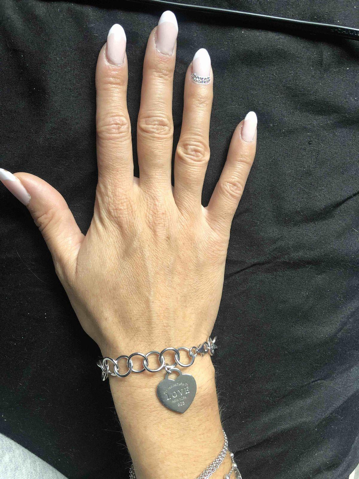 Крупный, серебряный браслет с кулоном в виде сердца