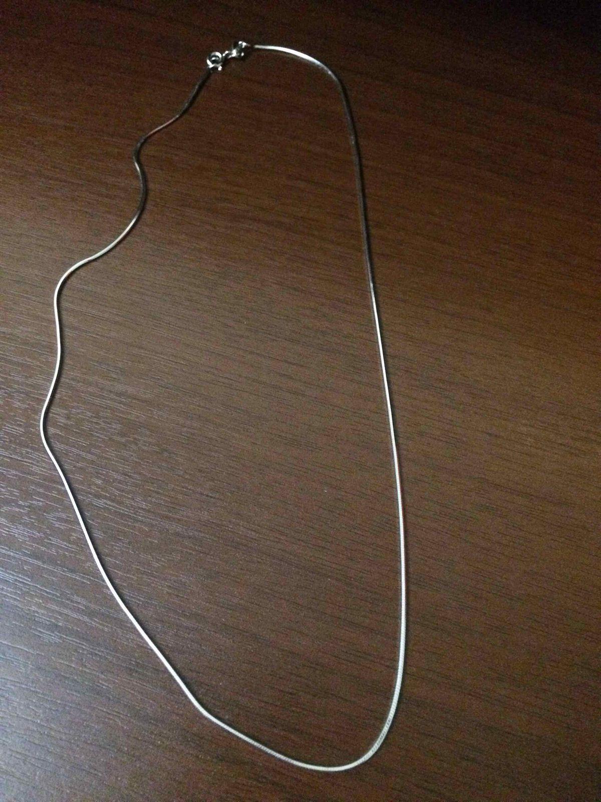 Серебряная цепочка плетения снейк.