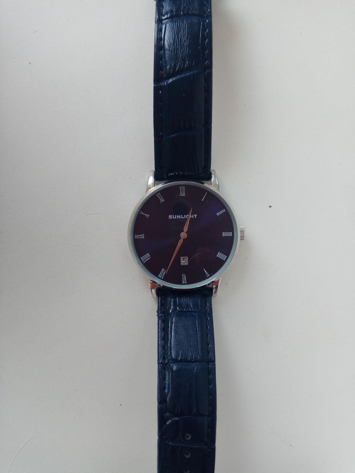 Часы от Санлайт.